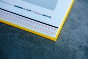 white book page with yellow cover